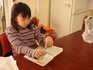 Youngest Kid, writing her story